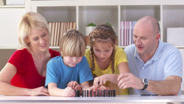 HD DOLLY: Family Playing Domino At Home