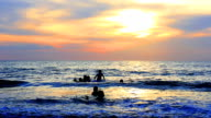 Family playing with Beautiful sunset at andaman beach Thailand