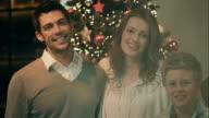 Family posing on christmas