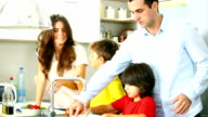 Family preparing food in a kitchen.