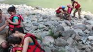 Family preparing for river rafting