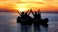 WS Family Rejoicing In Sea Kayaks At Sunset