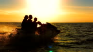 SLO MO Family Riding A Jet Boat At Dusk