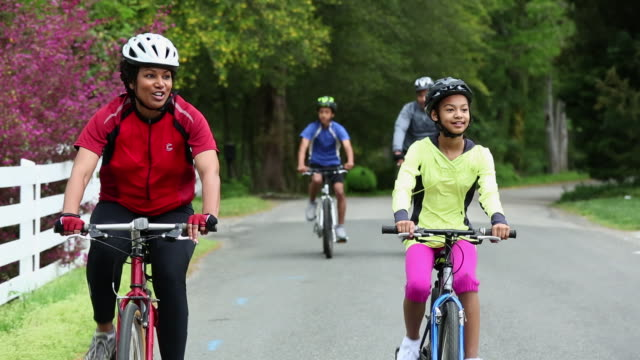 WS TS Family Riding Bicycles Together on Country Road / Richmond, Virginia, USA