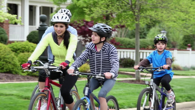MS TS Family Riding Bicycles Together Through Suburban Neighborhood / Richmond, Virginia, USA