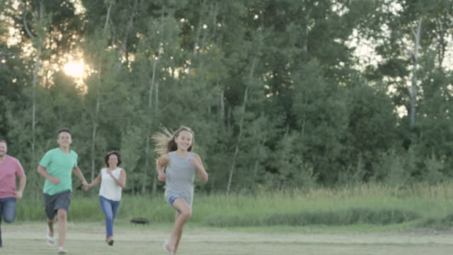 Family Running Together Outdoors