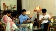 Family sitting at home, Delhi, India