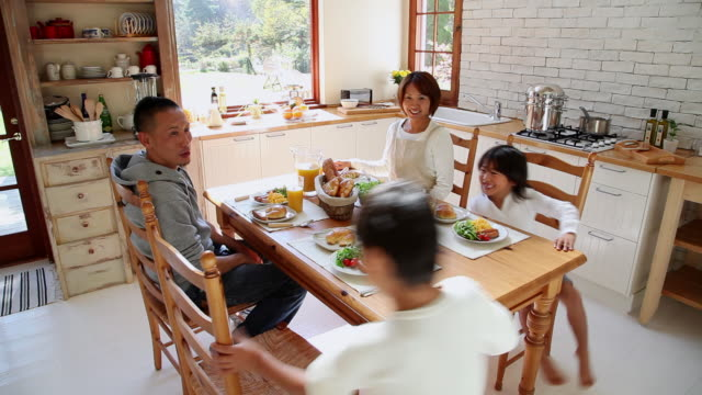 MS Family sitting down on table in kitchen / Fujikawaguchiko, Yamanashi, Japan