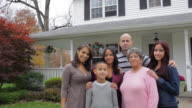 MS TD Family standing in front of house / Albany, New York, United States