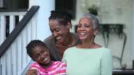 MS PAN Family standing on house porch / Richmond, Virginia, USA