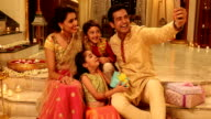 Family taking selfie in diwali festival, Delhi, India