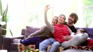 Family taking selfie in the living room