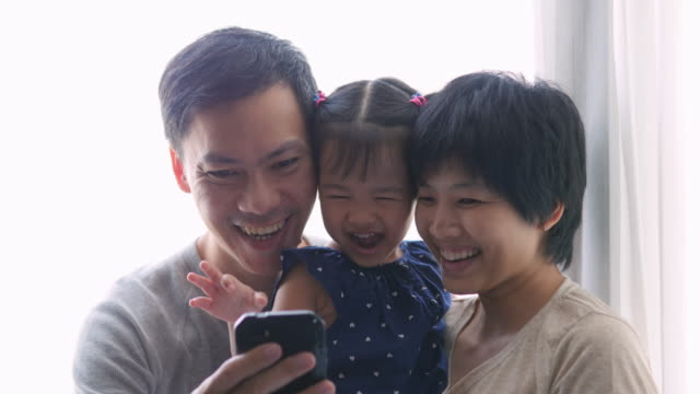 4K : Family taking selfie with mobile phone