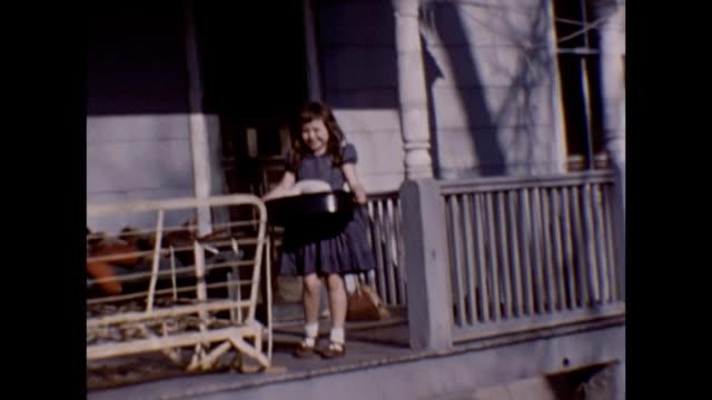1953 Family Teasing Kitten With Thanksgiving Turkey
