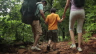 Family tracking in a forest, Malshej Ghat, Maharashtra, India