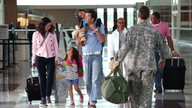 Family walking in airport terminal