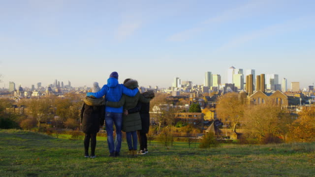 WS Family walking on a hill above the city