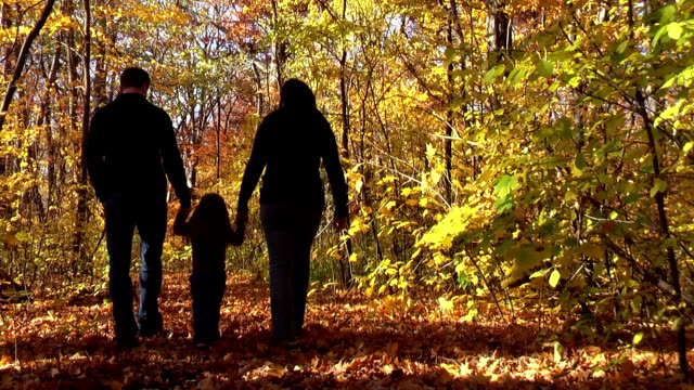 Family Walking Through Woods During Autumn in Michigan