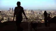 A family walks their dog on a mountain near Los Angeles.
