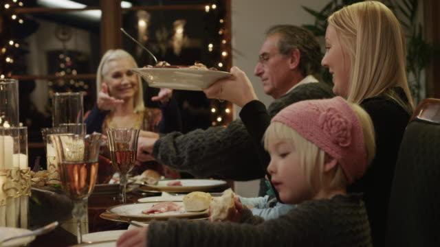 MS DS PAN Family with children (2-5 months,2-9 years) having Christmas dinner / Cedar Hills,Utah,USA