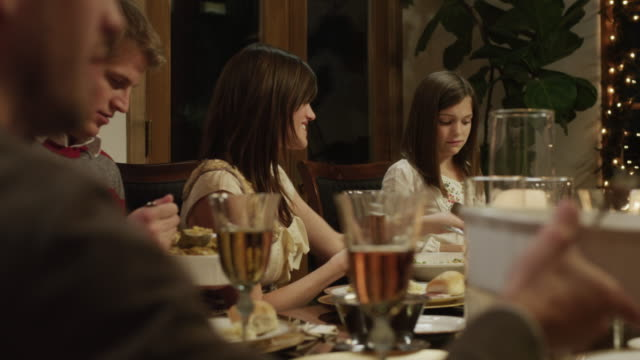 MS DS Family with children (2-5 months,2-9 years) having Christmas dinner / Cedar Hills,Utah,USA