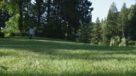 WS Family with daughter (12-13) walking through park / Edmonds, Washington State, USA