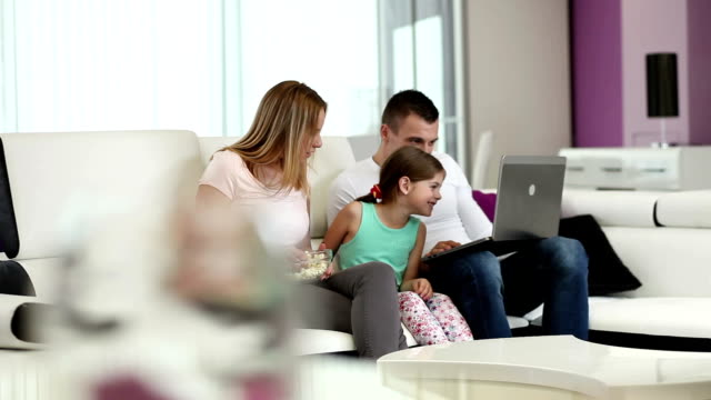 Family with laptop at home
