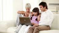 Family with laptop.
