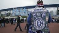 A fan poses in front of the VeltinsArena prior to the Bundesliga match between FC Schalke 04 and TSG 1899 Hoffenheim at VeltinsArena on March 30 2013...