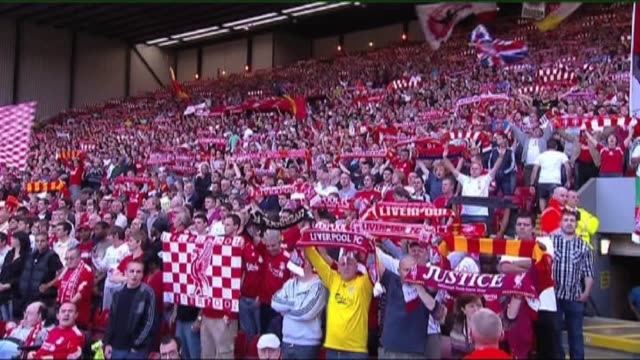 Fans and crowd shots from Manchester Utd Manchester City and Liverpool's famous Kop [no audio]Shots include 2 of fans waving liverpool flags and...