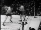 fans calling through cupped hands / Borsalino is knocked out Referee bends over him staring