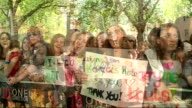 Fans camp out for premiere of One Direction film 'This is Us' ENGLAND London Leicester Square One Direction fans screaming and holding placards...