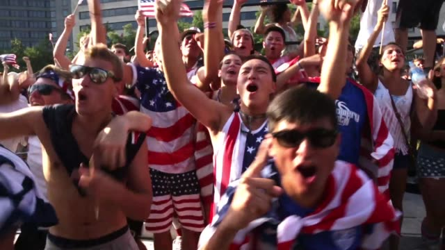 S fans celebrate after the US team scored the only goal in the World Cup United States vs Belgium match during a viewing party at the Freedom Plaza...