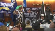 KTLA Fans cheer as the Carson City Council unanimously approved a privately financed stadium for the San Diego Chargers and Oakland Raiders on April...
