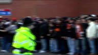 Manchester Old Trafford EXT Manchester United and Roma FC football fans clashing with police outside Old Trafford ground Police officers using batons...