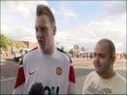 Fans comment on Wayne Rooney and the events surrounding his new contract at Manchester United