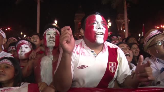 Fans gathered at Lima's Plaza de Armas celebrate Peru's opening goal scored by Jefferson Farfan against New Zealand in a crucial World Cup qualifier