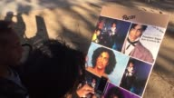 Fans hold a vigil/rally in Leimert Park Los Angeles honoring music legend Prince after his unexpected death A couple holds a poster with images of...