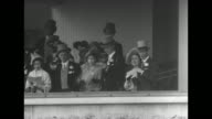 Fans in stands at Ascot Racecourse / Princess Margaret Princess Elizabeth Queen Elizabeth and King George VI in Royal Box prior to start of Ascot...