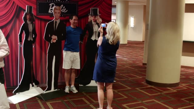 Fans pose for photographs with larger than life size cutouts of Barbie and Ken Fans gather for the 2015 National Barbie Doll Collectors Convention at...