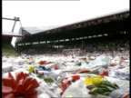 Fans tributes Pitch covered in flowers and scarves