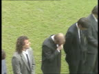 Fans tributes TS Players past and present standing on pitch as music played SOF