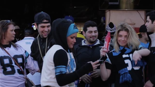 Fans wearing Carolina Panthers gear crowd into a bar called the Dog House near the Bank of America Stadium in Charlotte North Carolina on Game Day...
