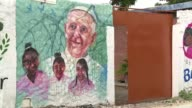 Far from the glamour of the touristic colonial city resident of Cartagena's impoverished San Francisco neighborhood eagerly await the arrival of Pope...
