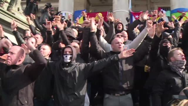 Far right football hooligans invade the square that has become a memorial to the victims of the Brussels attacks