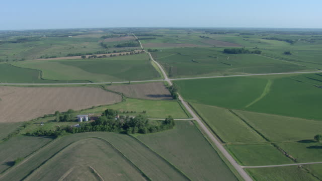 Farm fields and houses with intersecting gravel roads