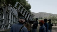 Farm workers offloading ladders from truck Piketberg is a small rural town in the Western Cape province of South Africa
