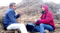 Farmer and Agronomist having Discussion Outdoor.
