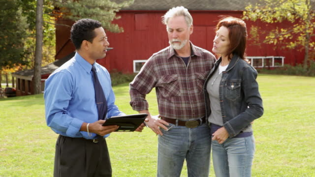 MS PAN Farmer and Wife having meeting with banker at farm / Warwick, New York,United States