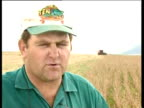 Farmer comments on President Mugabe's policies to seize land from white owners 1990s